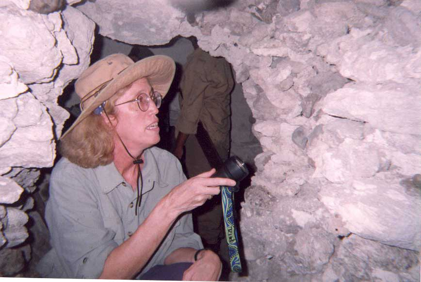 Inspecting  flint and obsidian tomb seals - Rio Azul