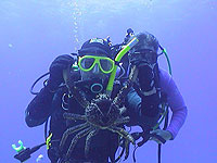 Scuba Divers with crab - photo by Pepe Scuba - Maya Expeditions