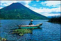 Local Fisherman in wooden cayuco boat on Lake Atitlan - Photo by INGUAT - Maya Expeditions